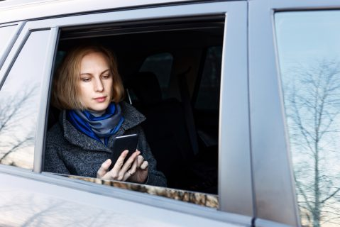 Image of a woman using ridesharing to access care.