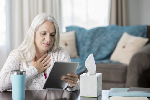 A senior woman has a telehealth appointment with her provider